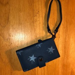 Coach blue and stars wristlet with phone holder